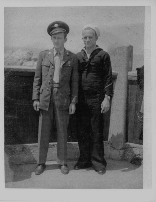 John R and Courtney Goyen in uniforms
